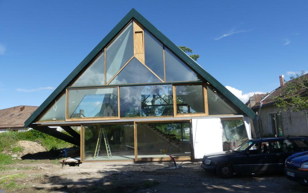 Transformation d'une grange en appartement à Vufflens-la-ville et remplacement de la toiture